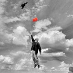 man in sky with balloons