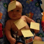 baby with sticky notes