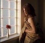 woman and flower by window
